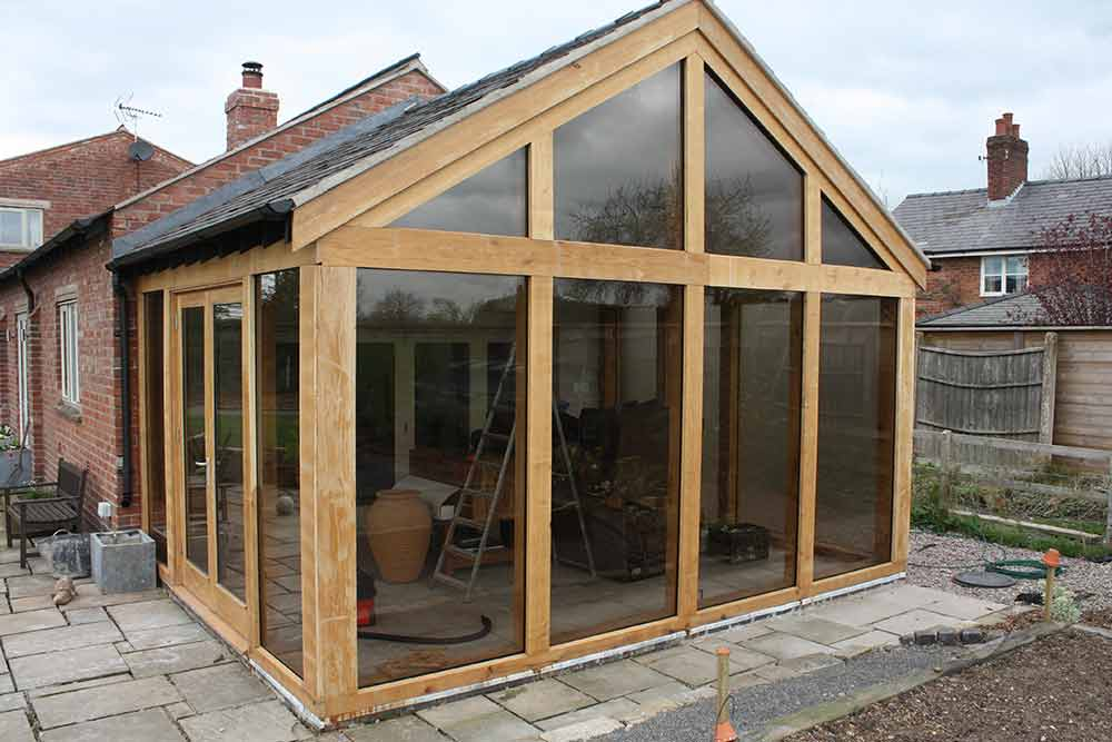 Oak framed garden rooms garden ftempo for Oak framed garden room