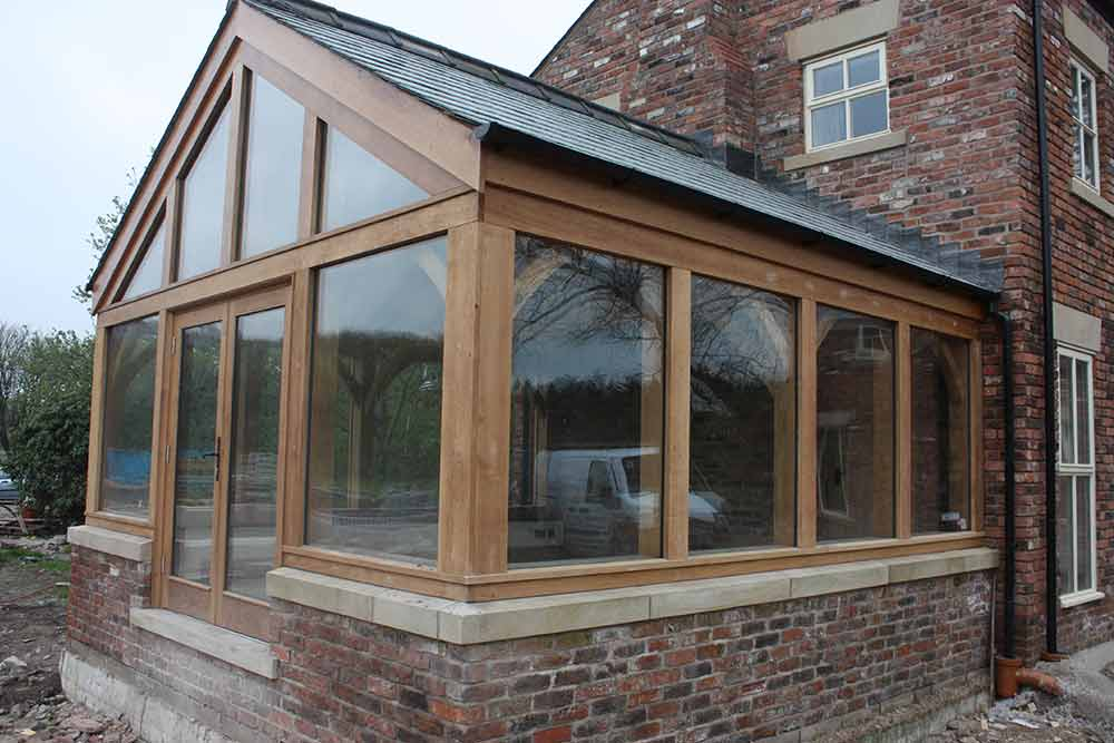 Image gallery oak framed garden room for Timber garden rooms